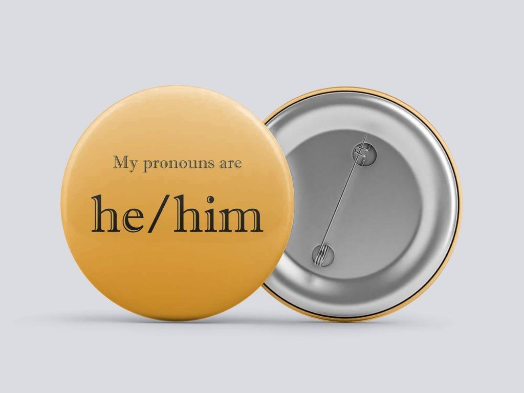 orange he/him gender pronoun button by Explore Sex Talk