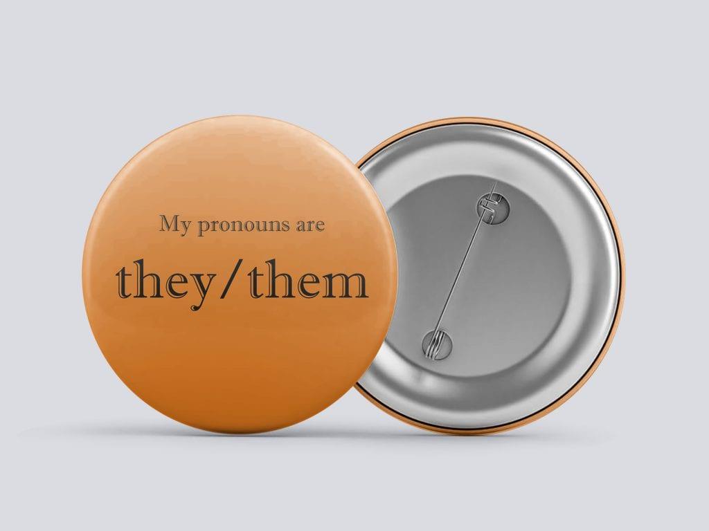 orange they/them gender pronoun button by Explore Sex Talk